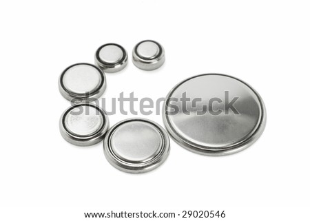 Lithium batteries of various sizes arranged on white background