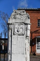 Lithuania, Kaunas, concrete pillar of the Catholic church cemetery fence