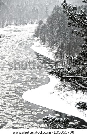 Lithuanian european winter landscape with snow and river, river and trees in winter season,river with the ice and snow in winter time background, black and white photo, winter landscape,Christmas time