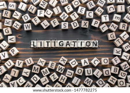 litigation - word from wooden blocks with letters, the process  determining issues a court Arbitration and Litigation concept, random letters around, top view on wooden background Zdjęcia stock ©