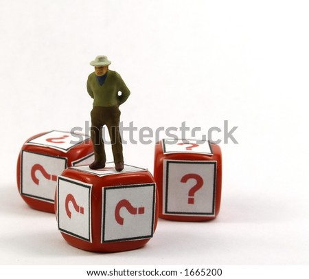 litle old man figure on a red die with question symbol