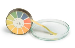 Litmus paper and beaker white isolated. Water PH tester. Yellow litmus roll.