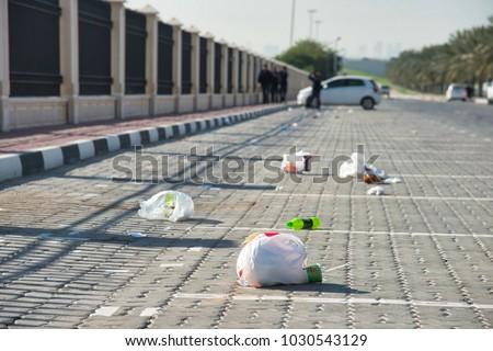 litter on a parking lot
