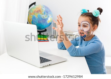 Little actress, little girl studying theater on laptop online