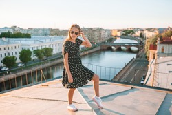 Little adorable girl on rooftop enjoying view of beautiful city of Saint Petersburg in Russia