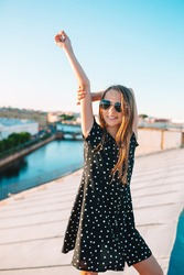 Little adorable girl on rooftop enjoying with view of beautiful sunset in Saint Petersburg in Russia