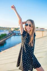 Little adorable girl on rooftop in Saint Petersburg in Russia