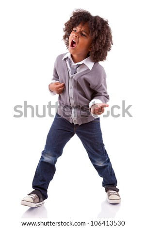 Little african american boy playing air guitar, isolated on white background