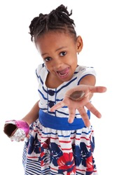 Little african american girl eating chocolate easter egg, isolated on white background