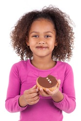 Little African Asian girl eating a chocolate cake, isolated on white background