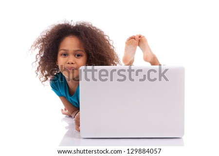 Little african asian girl using a laptop, isolated on white background