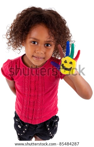 Little African Asian girl with painted hands in colorful paints - stock photo