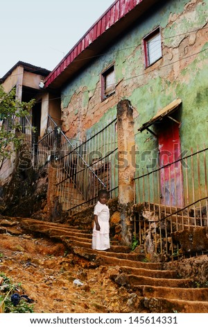 stock-photo-little-african-girl-toddler-in-stairs-of-old-creepy-concrete-buildings-in-the-city-poverty-145614331.jpg
