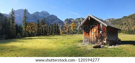 little alpine cabin in the valley bottom of karwendel, panorama landscape in austria