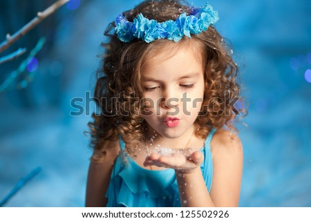 Little and cute winter fairy tale girl