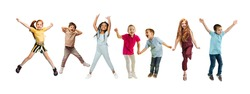 Little and happy kids gesturing isolated on white studio background. Human emotions, facial expression concept