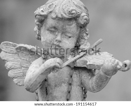 little angel playing violin -  detail of cemetery decor, Italy