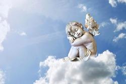 Little angel sleeping on the cloud