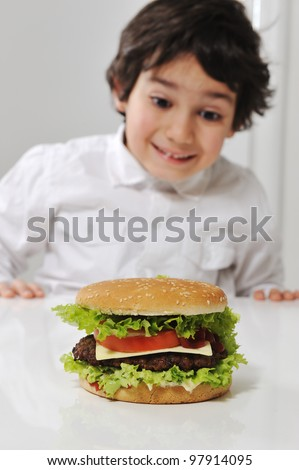 Little Arabic boy with burger