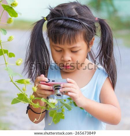 little asia girl taking photo