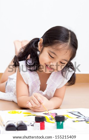 Little Asian artist kid drawing and painting