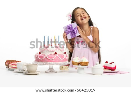 Little Asian beautiful girl celebrate her birthday, taking a present