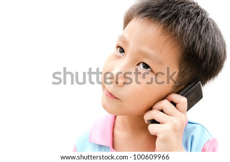 little Asian boy with a mobile phone