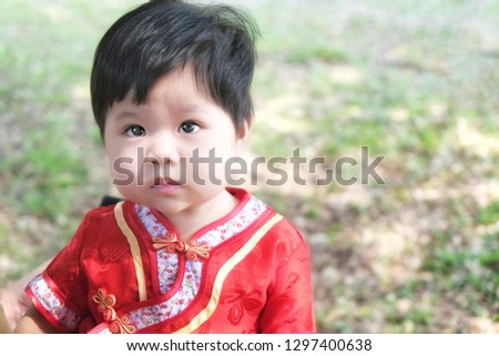 a86e346714ee3 Little Asian child girl wearing red cheongsam for Chinese New Year.  #1297400638