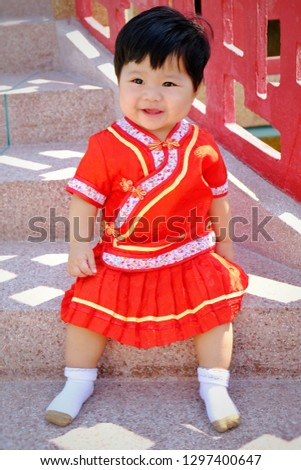 632e7ab388ba5 Little Asian child girl wearing red cheongsam for Chinese New Year.  #1297400647