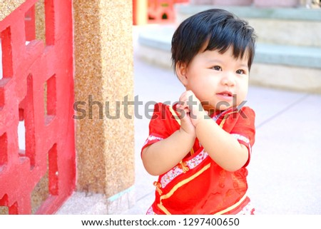 5fa5e2e914429 Little Asian child girl wearing red cheongsam for Chinese New Year.  #1297400650