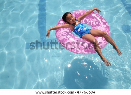 little asian child relaxing on the pool