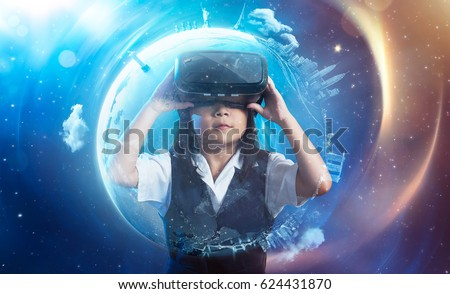 Little asian cute girl wearing virtual reality goggles with amazing cosmic futuristic space virtual imaging background .