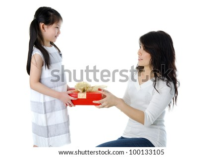 Little Asian girl arms out holding a beautiful wrapped present.