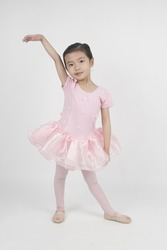 Little asian girl dancing in ballet tutu