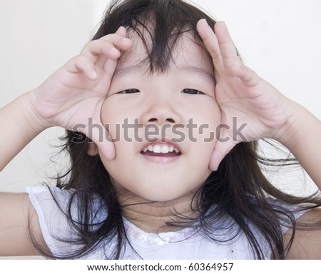 little asian girl in a funny pose