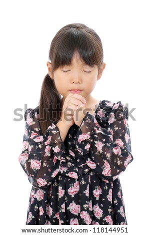 little asian girl praying against a white background