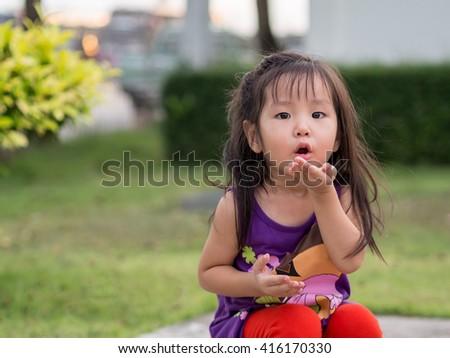 little asian girl sends kiss