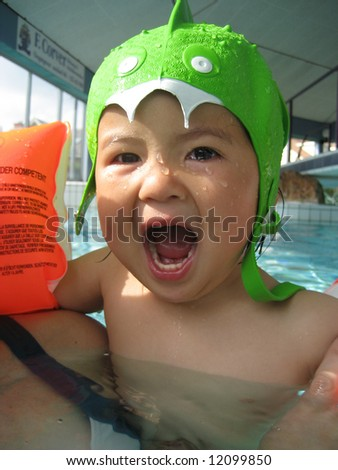 little asian girl wearing a monster swimhat