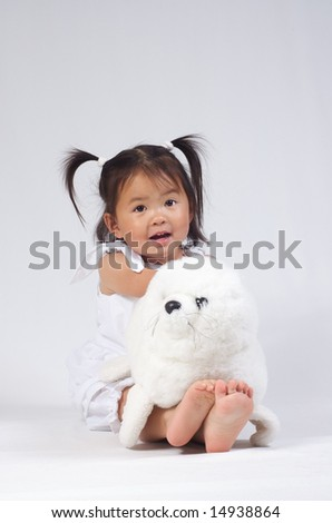 little asian girl with a seal bear