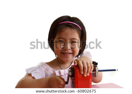 little asian girl with pencil Sharpener