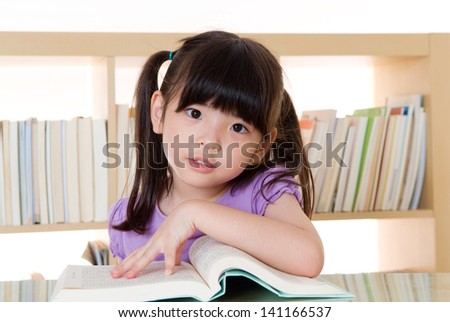 little asian school girl reading
