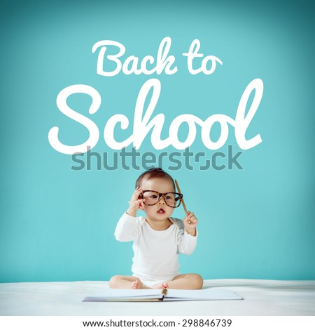 Little baby and blackboard with \