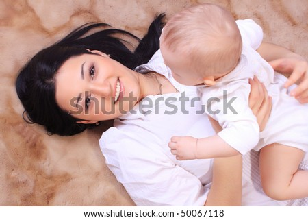 Little baby and mother on the floor