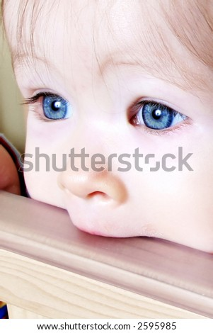 Little Baby biting on crib, taken closeup