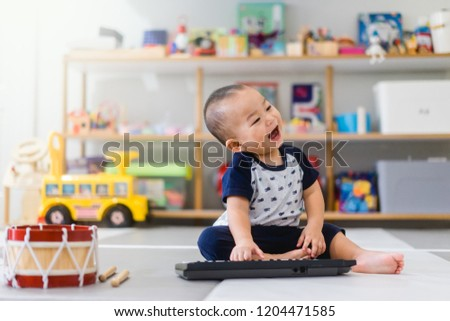 Little baby boy play keyboard and drum at home.Asian boy playing and singing happy moment in music time.