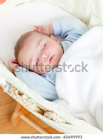 little baby boy sleeping in his bed