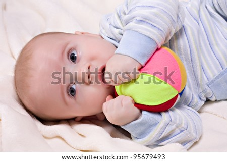 Little baby boy with teething toy