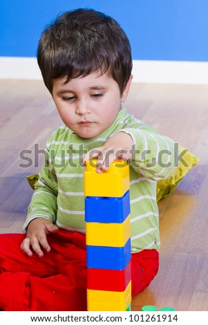 Little baby boy (2 years old) playing with toy blocks. Funny education - stock photo