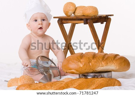 Stock Photo Little baby chef with bread