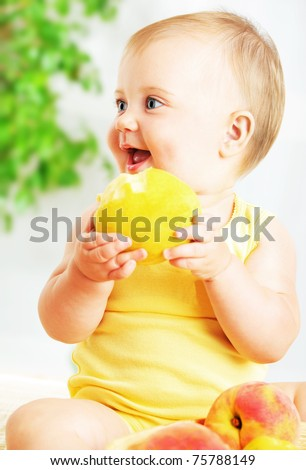 Little baby eating apple, closeup portrait, concept of health care & healthy child nutrition - stock photo